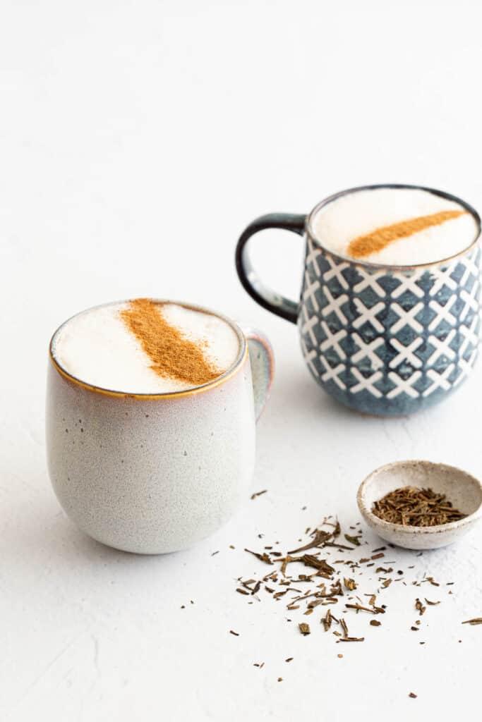 Two mugs of Japanese roasted green tea latte.