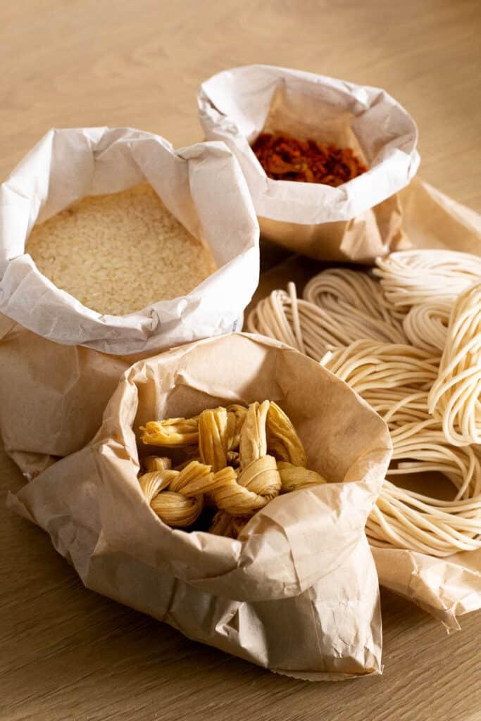 Bags of bulk Asian ingredients.