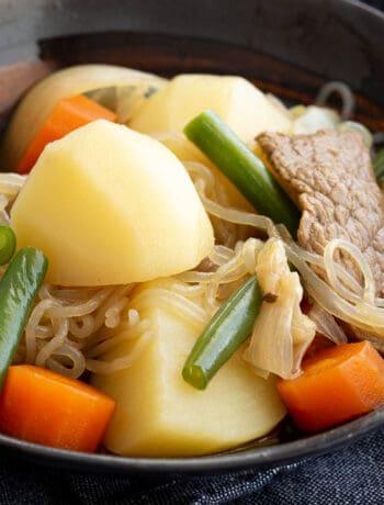 Nikujaga in a Japanese bowl with shirataki noodles.