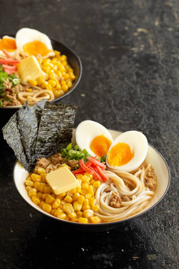 Miso ramen bowls with soft boiled eggs, corn, nori and buttered corn.