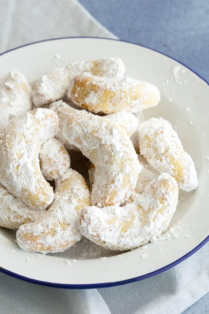 Plate of crescent shaped Italian shortbread.