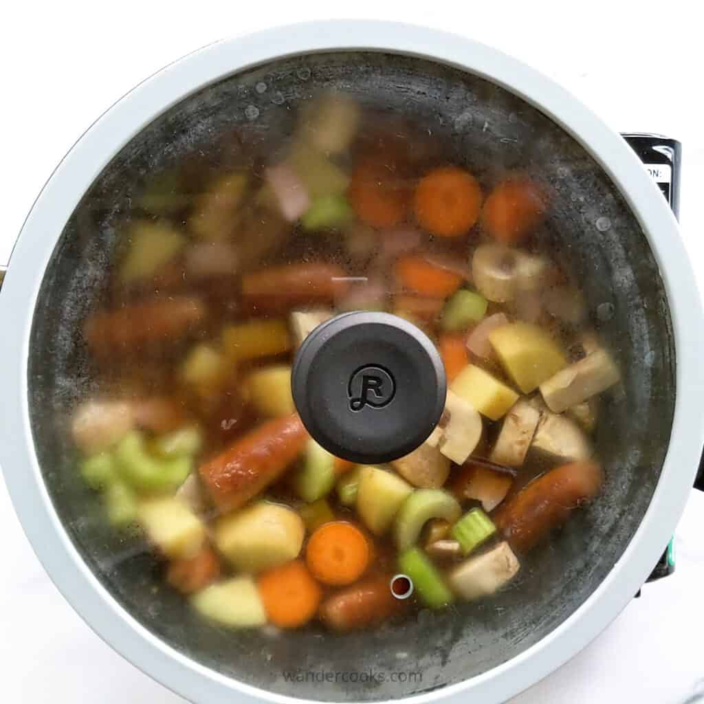 Cooking campfire stew in remoska with standard lid.